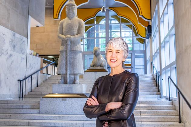 Photo of Amada Cruz, Illsley Ball Nordstrom Director and CEO, standing on the Seattle Art Museum's Grand Staircase